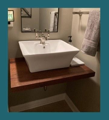 walnut plank-style floating vanity