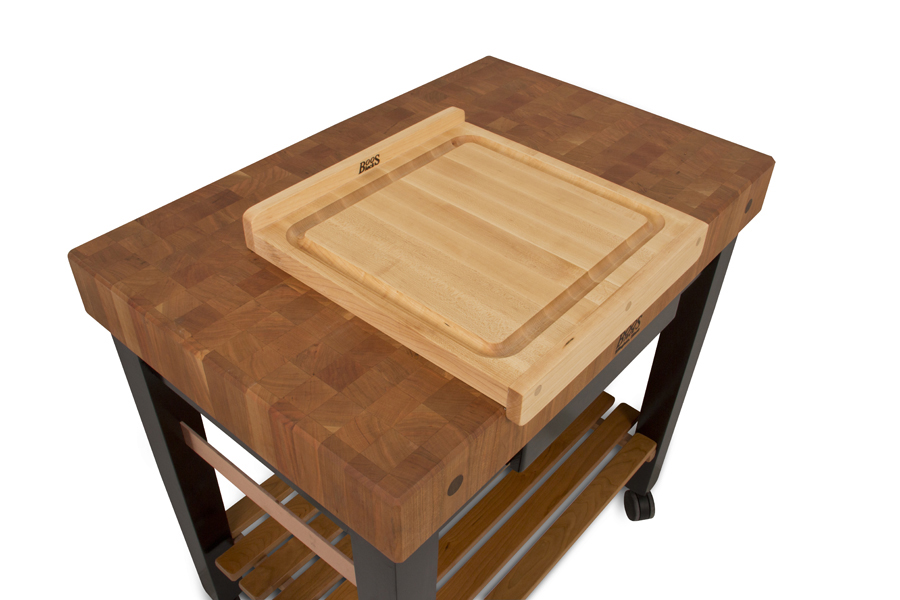 kneading cutting board atop butcher block cart