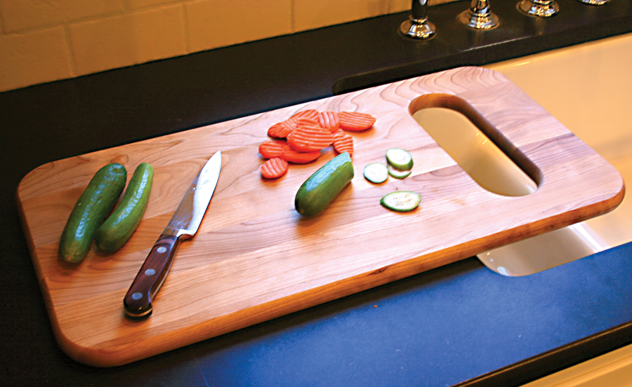 cutting board designed for use over the sink. Black Bedroom Furniture Sets. Home Design Ideas