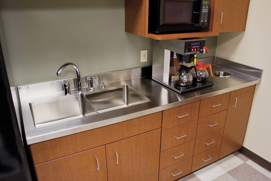 stainless steel countertop on kitchen cabinet