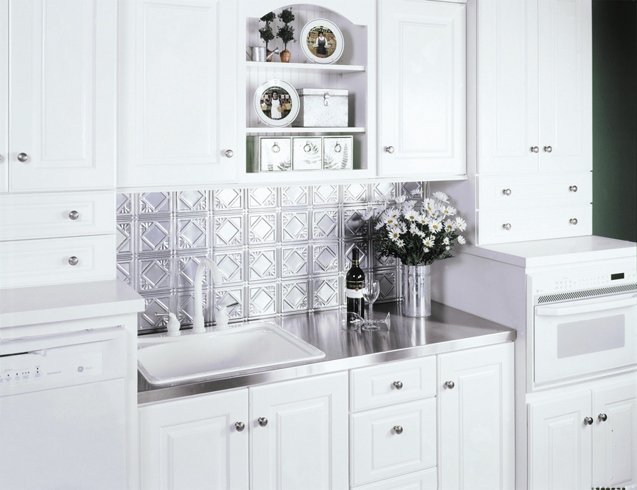 stainless steel countertop on white cabinets