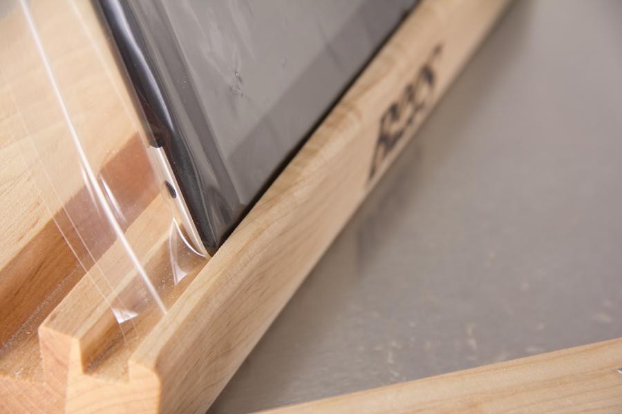 tablet in sleeve standing in slot in wood
